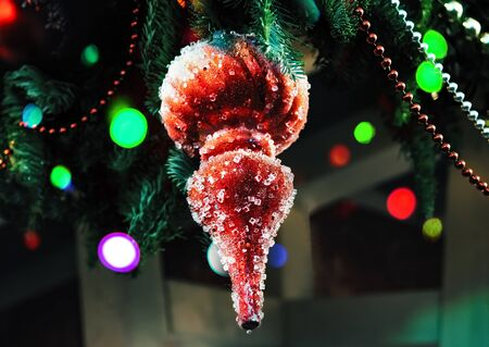 Red icicle with pieces of ice christmas tree decoration hanging on stret season fair. Christmas lights. Christmas decorations, Christmas tree toys - New Year holiday background