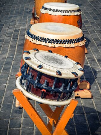 Traditional asian percussion instruments. Taiko or wadaiko or chu-daiko drum and shime-daiko or namitsuke ready for outdoor permormance 스톡 콘텐츠