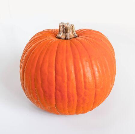 Small orange pumpkin isolated on white background.