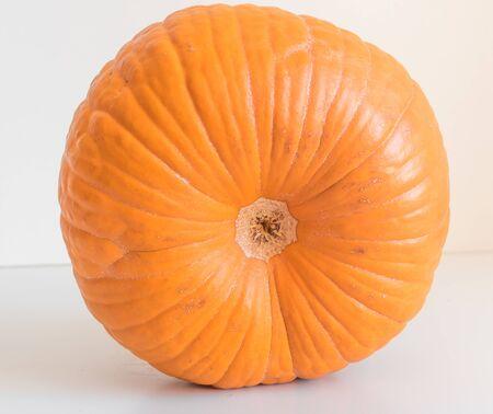 Small orange pumpkin isolated on white background 스톡 콘텐츠