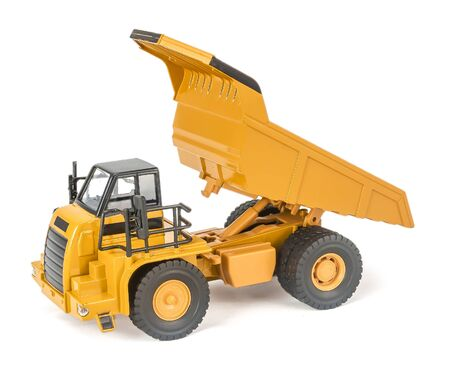 toy dump truck with upped open-box bed side view. Childrens toy plastic haul truck car with isolated on white background