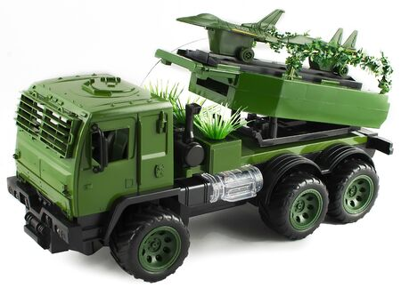 Army green military toy vehicle fighters board. Launcher Fighter Military Truck Toy military launcher fighter aircraf transporter 스톡 콘텐츠