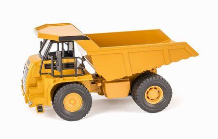 Toy dump truck with open-box bed. Childrens toy plastic haul truck car with isolated on white background