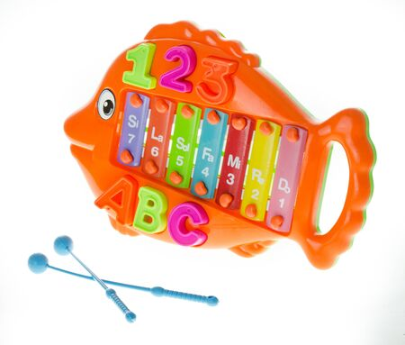 Colorful metallophone or xylophone in form of fish- musical and developing toy. Development of fine motor skills of hands and hearing 스톡 콘텐츠