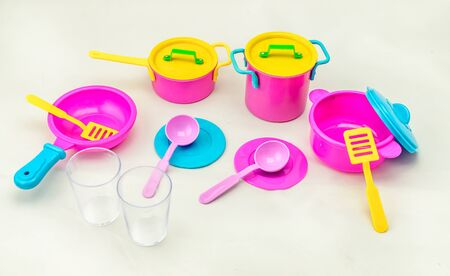 Set of childrens toy colorful dishes isolated on white background. Kid toy utensil for girls game 스톡 콘텐츠