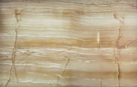 Natural marble stone for interior decoration. Real natural marble stone and surface background. Facing the interior with decorative stone