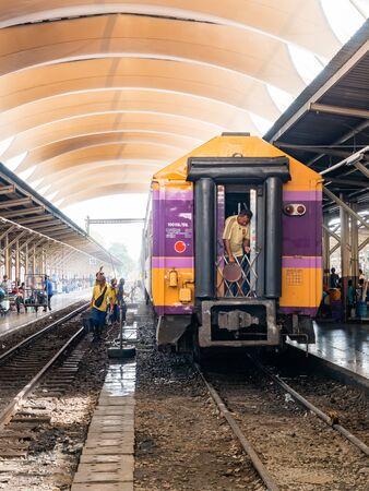 Bangkok, Thailand - May 25, 2019: An employee washes a railway passenger car at Hua Lamphong, A group of workers washes train cars at the Bangkok main train station Redakční