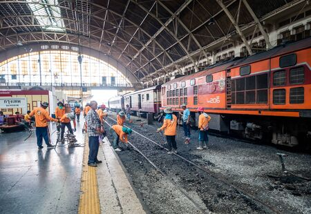 Bangkok, Thailand - May 25, 2019: Repair works on the Hua Lamphong railway station. Laying of new railway rails on a city. Railway repair. Installation of new modern railway rails. Installing the latches on railway sleepers. Reconstruction of railway