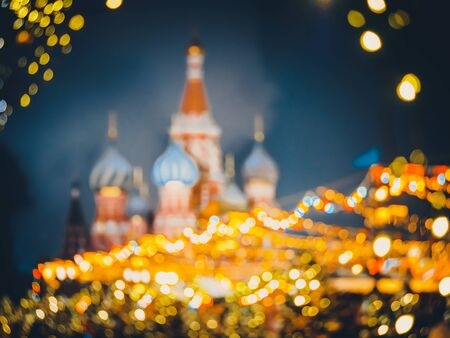 Festive blurred background of St. Basils Cathedral or Cathedral of Vasily the Blessed or Cathedral of the Intercession of the Most Holy Theotokos on the Moat or Pokrovsky Cathedral. Moscow Kremlin on decorated Red Square. Chrismastide and New Year time in Russia. Stockfoto