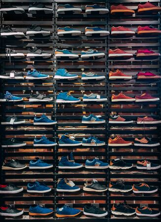 .A various types of shoes at Sport Direct shelf display rack. Stockfoto