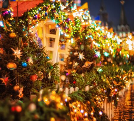 Festive street decoration in Moscow. Christmas fir tree garland illumination lights with christmas tree decoration. Bright Christmas and New Year background.