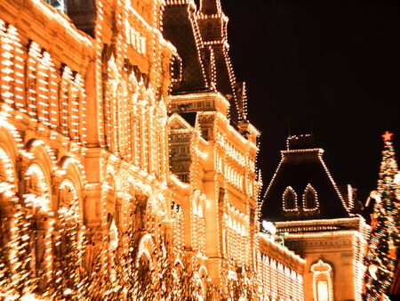 Illuminated lights on facade of GUM Festive background. Christmas illuminations and decorations of Christmas and New Year in Moscow, Russia. Red Square.