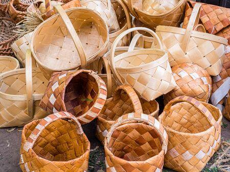 A bunch of wicker baskets in retro style. Heap of birch baskets. Pile of birch bark bast baskets.