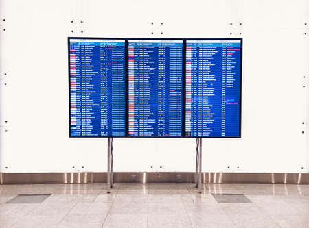 Moscow, Russia - May 6, 2019: Electronic scoreboard flights and airlines. Various destinations on a light board. Airport flight information arrival displayed on departure board, flight status changing.