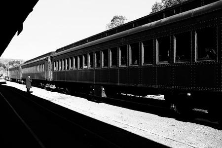 disembark: Conductor and train Stock Photo