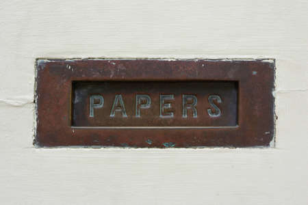 The word  PAPERS  written on a rusty plate Stock Photo