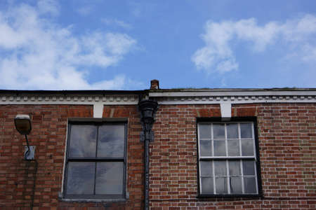 Two windows on a wall of British style house Stock Photo