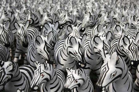 Plenty of small zebra statues in Thai temple