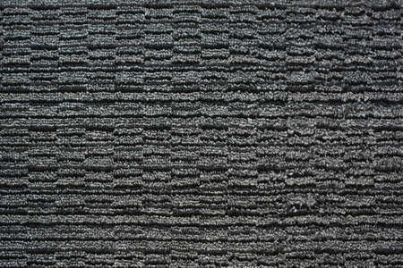 Pattern of a gray black woven carpet photo