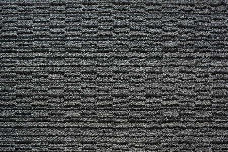 Pattern of a gray black woven carpet