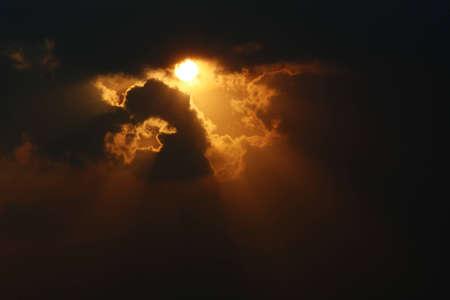 Sun among clouds with sunbeam Stock Photo