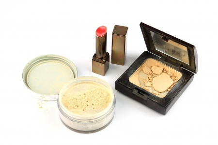 Cosmetics isolated  used lipstick and crushed powder