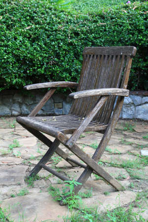 Old wooden chair in a garden Stock Photo