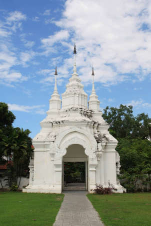 Thai style ancient white temple gate photo