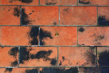 Very dirty orange brick floor Stock Photo