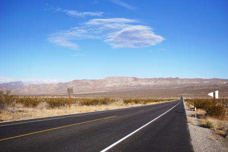Long road with nice blue sky Stock Photo