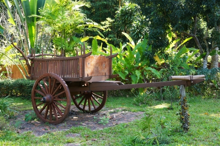 Ancient Thai styled wooden bullock cart Stock Photo