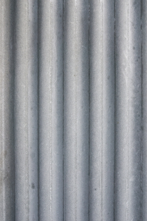 Vertical gray corrugated roof tile