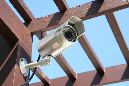 Outdoor Silver CCTV Camera with Blue Sky