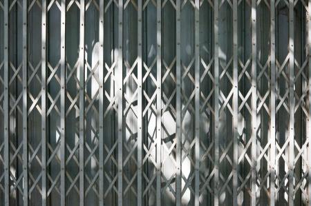 Old styled steel door in sunlight