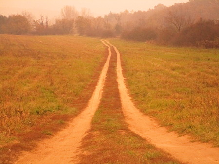 the distance: dirt road into the distance Stock Photo