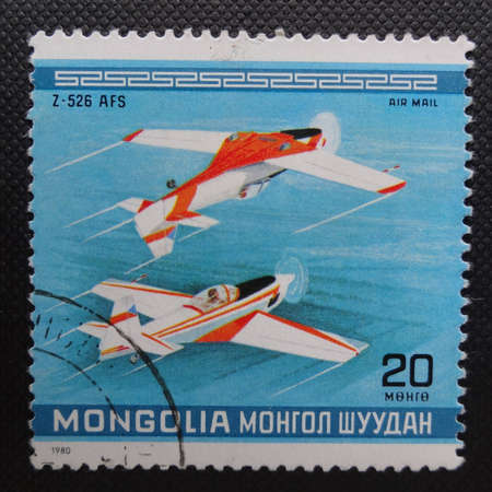 MONGOLIA - CIRCA 1980: A stamp printed in MONGOLIA commemorates World Acrobatic Championship in Oshkosh in Wisconsin and it shows a Czechoslovakian Zlin Z-526 AFs Akrobat Special, circa 1980.