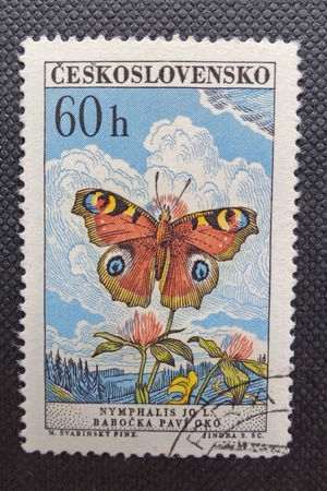 CZECHOSLOVAKIA - CIRCA 1961: A stamp printed in former CZECHOSLOVAKIA shows Peacock Butterfly (Nymphalis jo L). The author is Max Svabinky, circa 1961