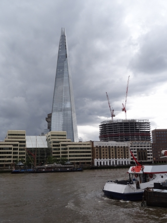 London, Great Britain - July 7 2012: The Shard and the River Thames on a cloudy day.