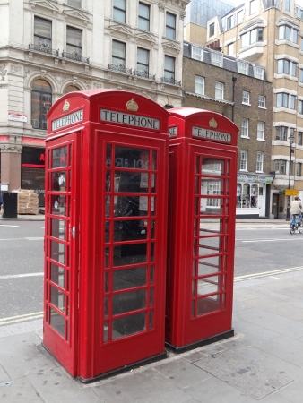 London, UK - July 7 2012: Typical Red London Telephone Booth