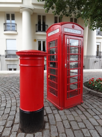 Typical Red London Telephone Booth and Pillar Box                                photo