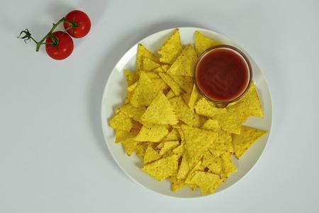dip: Nachos with Tomato Dip on White Background Stock Photo