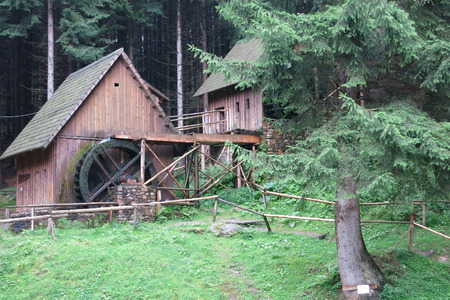 Zlate Hory, Czech Republic - August 1 2016: Replicas of medieval gold mine water mills in an open-air museum in Zlate Hory, Czech Republic.