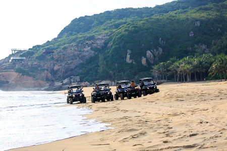 China's Hainan Nanwan Monkey Island Colorful Beach ATV 版權商用圖片 - 107820915