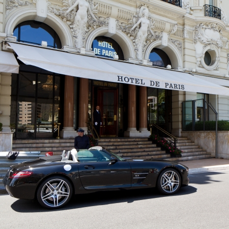 carlo: MONTE CARLO - MAY 23 - Luxury car parked in front of Hotel on May 23, 2012 in Monaco