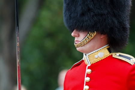 LONDON - JULY 4 - Officer marching towards Buckingham Palace during Changing of the Guard ceremony on July 4, 2012 in London