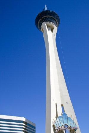 stratosphere: LAS VEGAS - SEPTEMBER 14 - Stratosphere Tower with man enjoying one of it