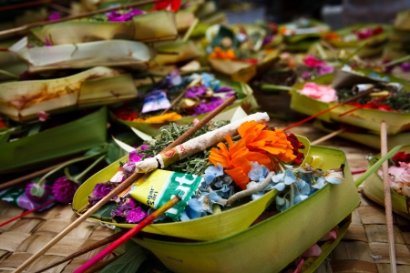 guilty pleasures: DENPASAR, INDONESIA - SEPTEMBER 12: Offerings to gods in the temple on September 12, 2011 in Denpasar. With offerings Balinese maintain a good relationship between people and spirits.
