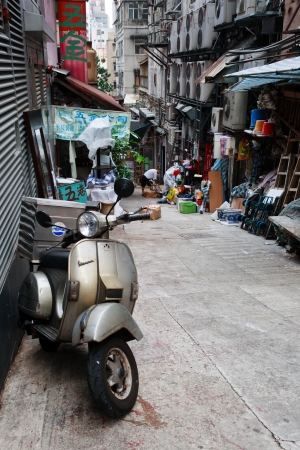 backstreet: HONG KONG - SEPTEMBER 19: Well-used scooter parked in backstreet on September 19, 2011 in Hong Kong. Riding a scooter here is not advisable for tourists due to high traffic and driving style of locals. Editorial