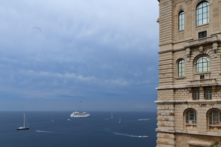 oceanographic: Mediterranean Sea with birds, boats and cruise ship and with part of Oceanographic Museum building on the right, Monte Carlo, Monaco  Editorial