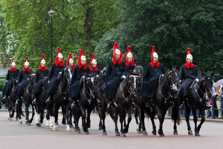 LONDON - JULY 4: Horse Guards arrive to Buckingham Palace during Changing the Guard ceremony on July 4, 2012 in London. Changing the Guard takes place at 11.30 am daily from May to July.